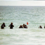 Steve takes his open water class into the surf